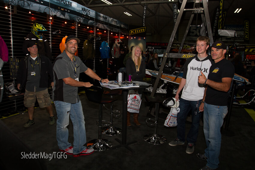 Dan Adams and 600 mod RMSHA world champ Cole Whitford signing posters at Klim.