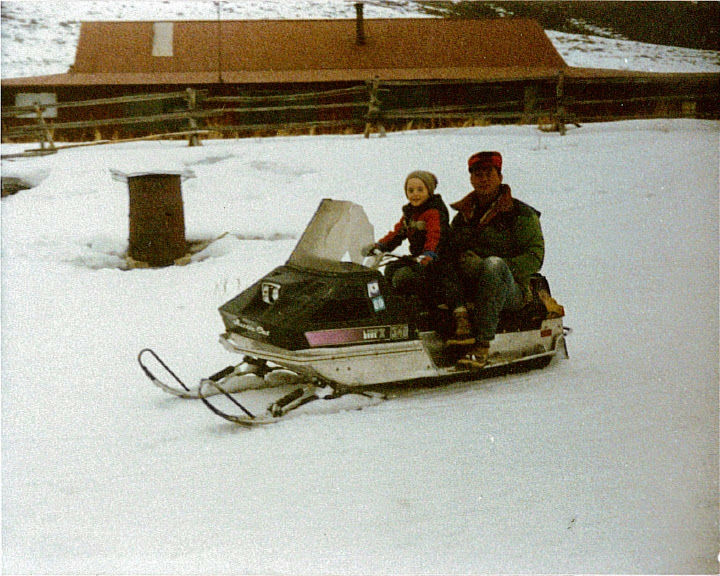 Riding on Dad's knee on the Lynx II.