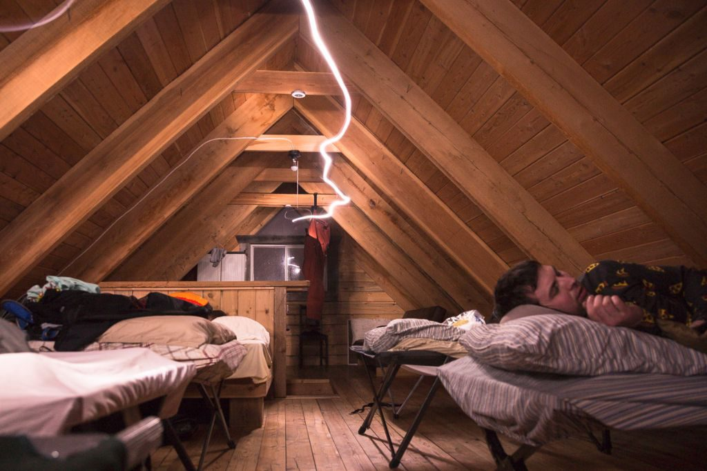 Cozy cots and a couple of double beds  sleep up to twelve in the upstairs loft.