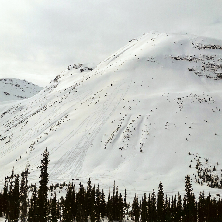 Avalanche Alley at Clemina Creek near Valemount, BC. Notice the riders in the exposed location.