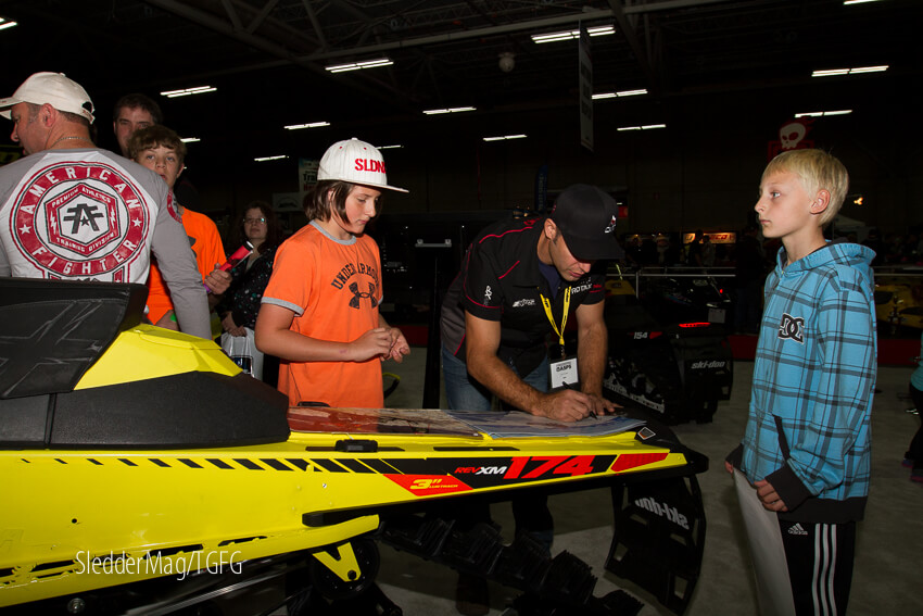 Carl Kuster at the BRP booth stoking up the groms.