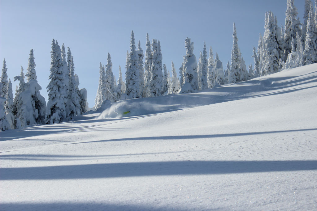 Carving deep all day long under blue sky's in the Revy Backcountry.   PC: Austin Christopher