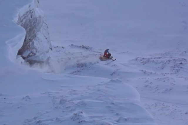 Guy rides snowmobile off 1600′ cliff