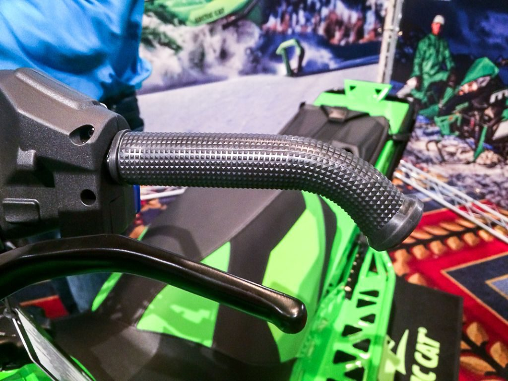 Arctic Cat M series sleds come with a new handlebar that sheds 0.5lb as part of a 4-6.5lb overall weight reduction, depending on model.
