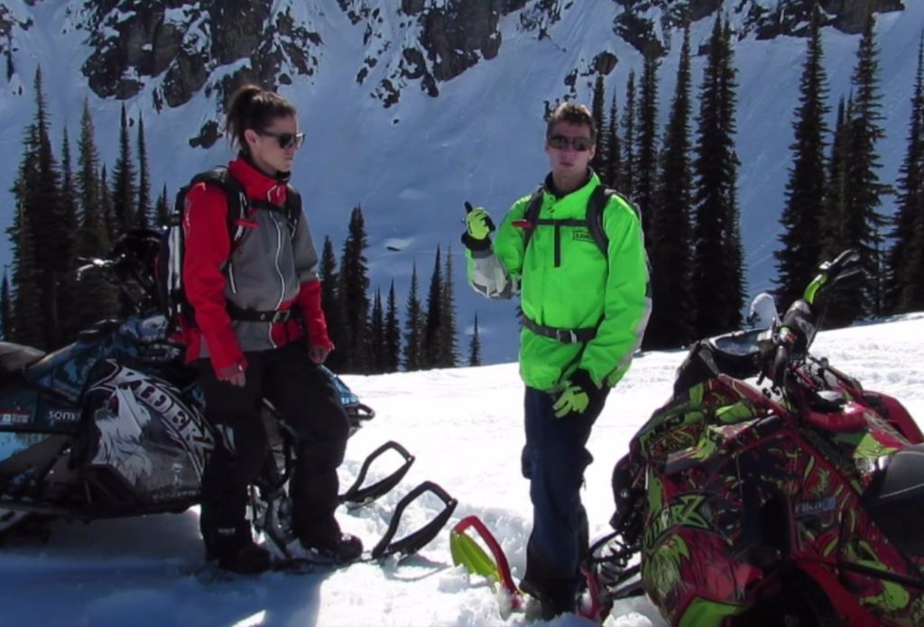 Nadine and Brodie stop to talk about specific terrain features and key points mentioned in the Bulletin.