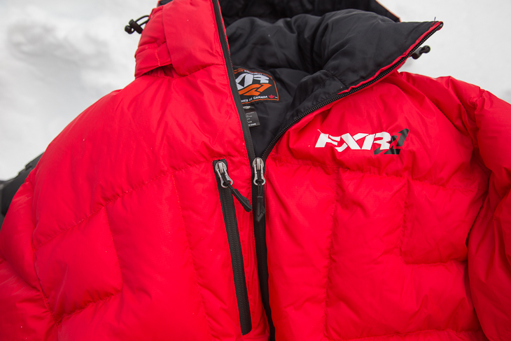 Waterproof zips are found throughout, including the main zip and on the chest pocket.