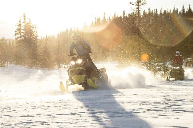 Optimism Abroad – Snowmobiling in Sweden for XX Freeriders Camp
